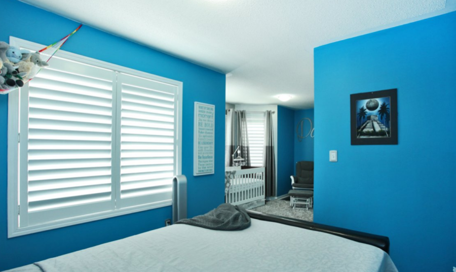 Blue Wall For Baby Room with Metallic Silver Finish Around Windows