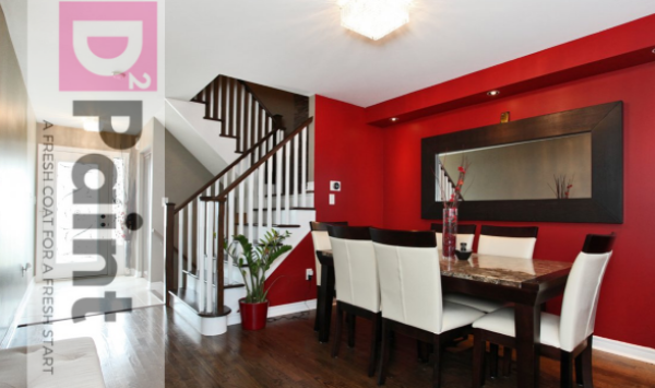 Freshly painted red feature wall in the kitchen, and earth tones throughout. White stair case finishes.
